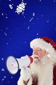 Santa Claus is using a megaphone against blue snowflake background
