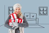 Happy blonde with gifts against grey vignette