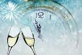 stock photo of midnight  - Glasses with champagne against fireworks and vintage clock close to midnight - JPG