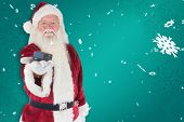 Santa shows a little box against green snowflake background
