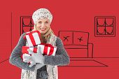 Happy blonde with gifts against red vignette