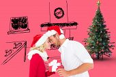 Young festive couple against pink