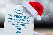 German christmas greeting against shimmering light design over boards