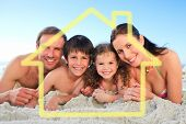 Family at the beach against house outline