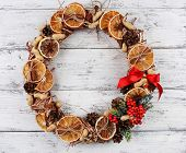 Christmas wreath on color wooden background