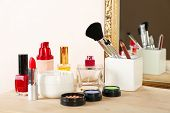 Different cosmetics on dressing table, close up
