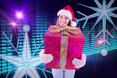 Festive young woman holding a gift against digitally generated disco light design