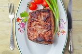 Roast beef  and vegetables on a plate