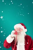 Santa claus on the phone against green