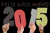Hands holding poster against glittering feliz ano nuevo
