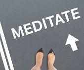 Businesswomans feet against grey