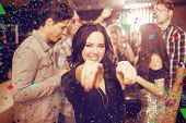 Stylish brunette smiling and dancing against flying colours