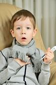 Boy Coughing And Holding A Thermometer