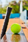 Tennis Racket And Ball On The Bench At The Court