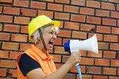 Woman builder with a megaphone