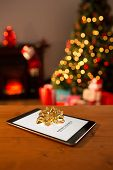 Diet new years resolution against tablet with bow for christmas