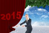 Businesswoman pulling a rope against christmas scene