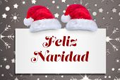 Feliz navidad against snowflake wallpaper pattern