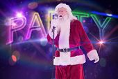 Santa sings like a Superstar against digitally generated colourful party text