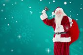Santa claus ringing bell against green snowflake background