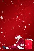 Santa sits leaned on his bag against red snowflake background