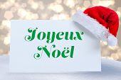 Joyeux noel against light glowing dots design pattern