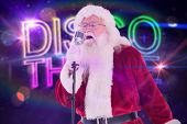Santa Claus is singing Christmas songs against digitally generated colourful discotheque text