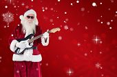 Santa Claus plays guitar with sunglasses against red snowflake background
