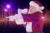 Santa points at something and uses a megaphone against digitally generated disco light design