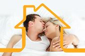 Boyfriend kissing her girlfriend in bed against house outline