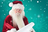 Santa writes something with a feather against green snowflake background