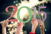 Hands holding poster against black and gold new year graphic