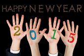 Business peoples hands against glittering happy new year