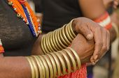 stock photo of bangles  - bangles worn by a tribal woman during post harvest festival - JPG