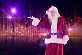 Santa shows something to camera against digitally generated disco light design