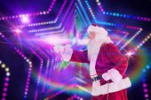 Santa pulls something with a rope against digitally generated star laser background