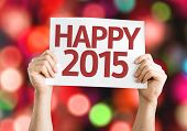 Happy 2015 card with colorful background with defocused lights