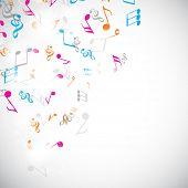 Colorful musical notes on shiny stylish light grey background.