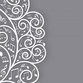 Musical notes with floral design on grey background.