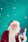Santa Claus shows a smartphone against green snowflake background