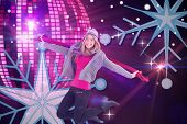 Pretty blonde posing in winter clothes against digitally generated cool disco ball design