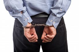 picture of handcuff  - Close up of a man in handcuffs arrested isolated on white - JPG