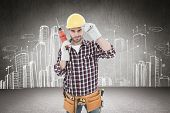 picture of hand drill  - Confident handyman holding drill machine against hand drawn city plan - JPG