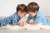 foto of wrestling  - Arm wrestling and two joy brothers indoor - JPG