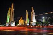 stock photo of democracy  - The Democracy Monument At Night Time In Bangkok - JPG