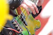 image of guitarists  - Picture of a guitarist plays electric bass - JPG