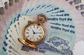 stock photo of indian currency  - Indian Currency Rupee Notes With Antique Watch - JPG