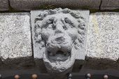 picture of lions-head  - Above the entrance to the grotto  - JPG