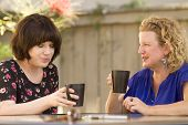 pic of comrades  - Women and friendship sharing stories over a cup of coffee outdoors - JPG