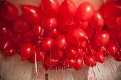 stock photo of helium  - very many red heart balloons filled with helium at a ceiling - JPG